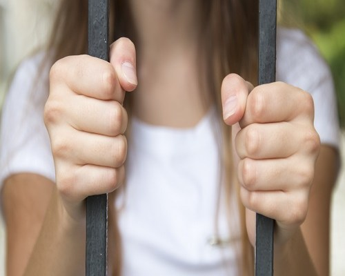 hand in jail, behind bars