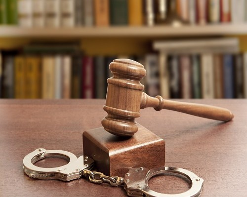 gavel and handcuffs, first time in prison