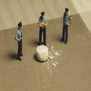 prison officers standing around white substance