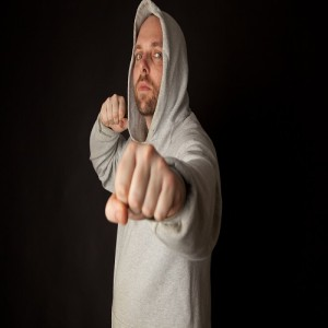 Man in hodded jumper fighting pose