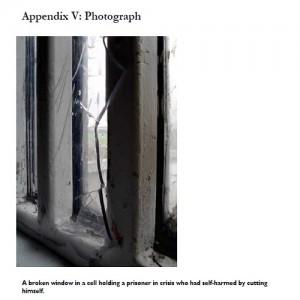 Wormwood scrubs broken window picture from 2015 report