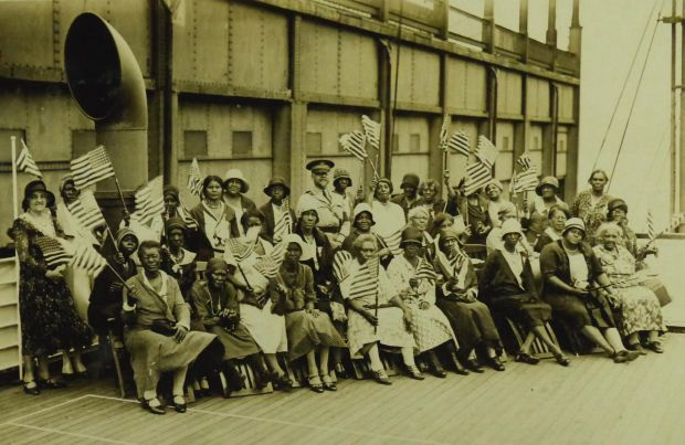 "Party K before sailing from New York on July 19, 1931. The women are pictured with Col. Benjamin O. Davis, Sr. (1877-1970), who was then the highest-ranking African American in the U.S. Army. He served as Liaison Officer for all six of the black pilgrimages, overseeing the parties during their weeklong journeys to and from Europe. In the report he filed concerning the first pilgrimage, he wrote of the women: ""They are returning to their homes with a feeling of gratefulness to the Government and with renewed faith in the principles upon which our Government is founded; and the feeling that their sons and husbands have not died in vain."" Davis's own experience in World War I had been deeply frustrating; the Army, unwilling to allow him to command troops in Europe, consigned him to the Philippines."