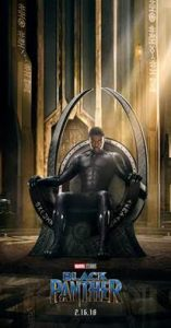 A poster advertising Blank Panther shows the main character seated on a throne in a large hall.