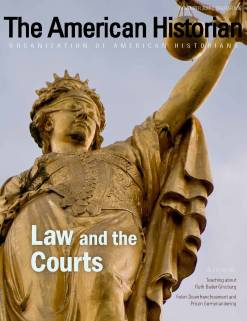 The cover of the November issue of The American Historian featuring a statue of blind justice.