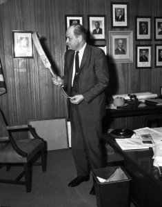"TDC director Geroge Beto posing with the ""bat,"" Texas's principal instrument of convict discipline from antebellum times through World War II. Photo 1965. Courtesy of TDCJ."