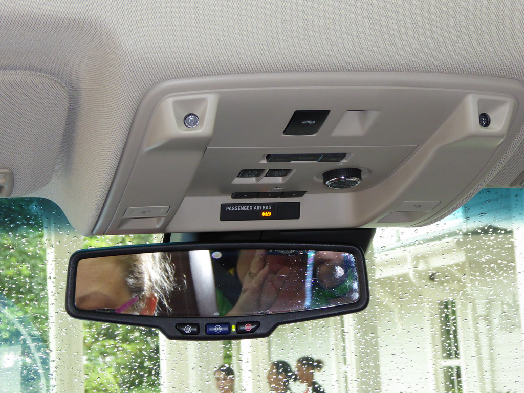 OnStar security system integrated into the rear-view mirror. Image courtesy of DebMomOf3 on Flickr / CC BY-ND 2.0