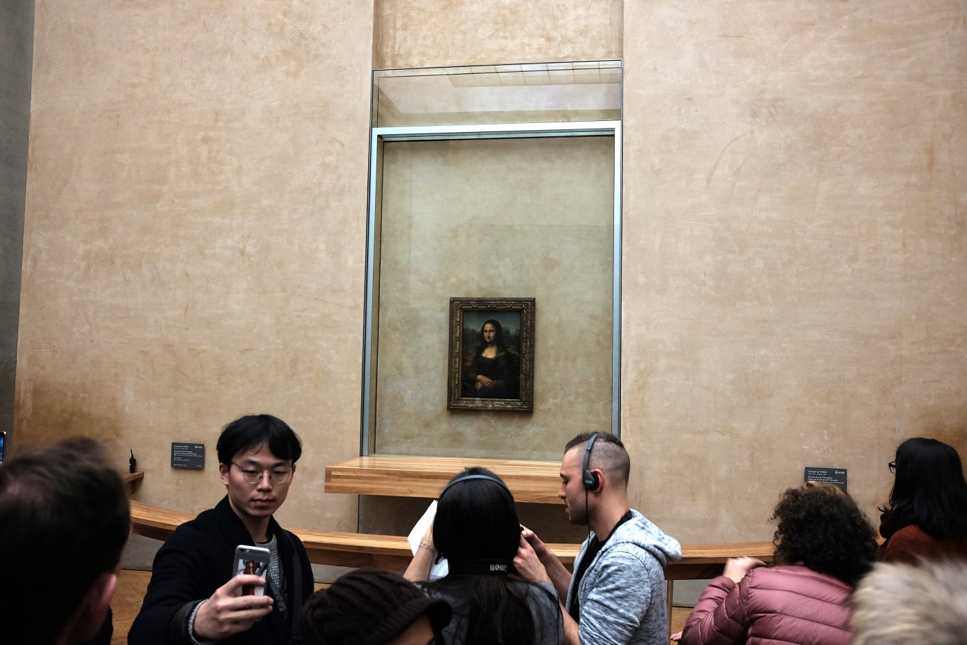 Leonardo da Vinci's Mona Lisa on display at the Louvre, which also houses multiple Breguet timepieces