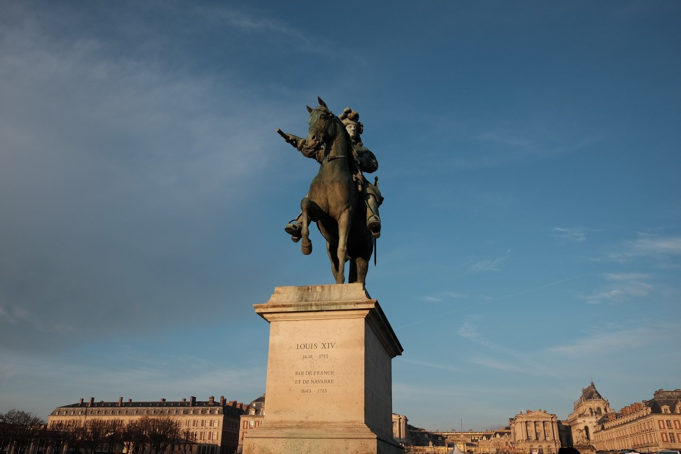 Louis XIV statue at the entrance to the Palace of Versailles