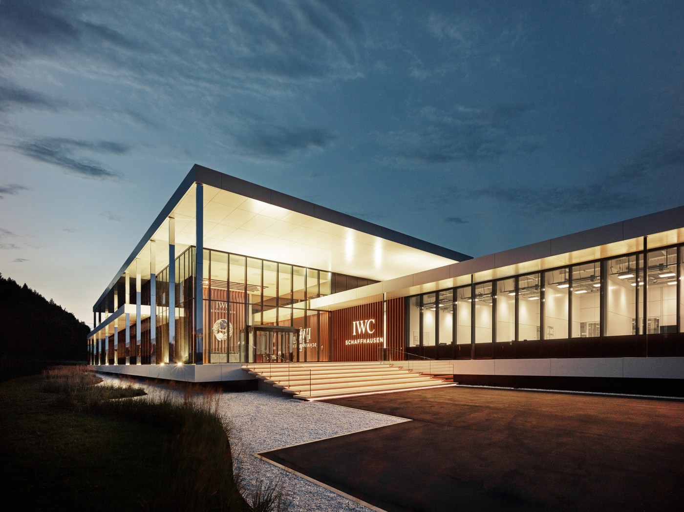 IWC Manufacturing Center exterior view main entrance at night