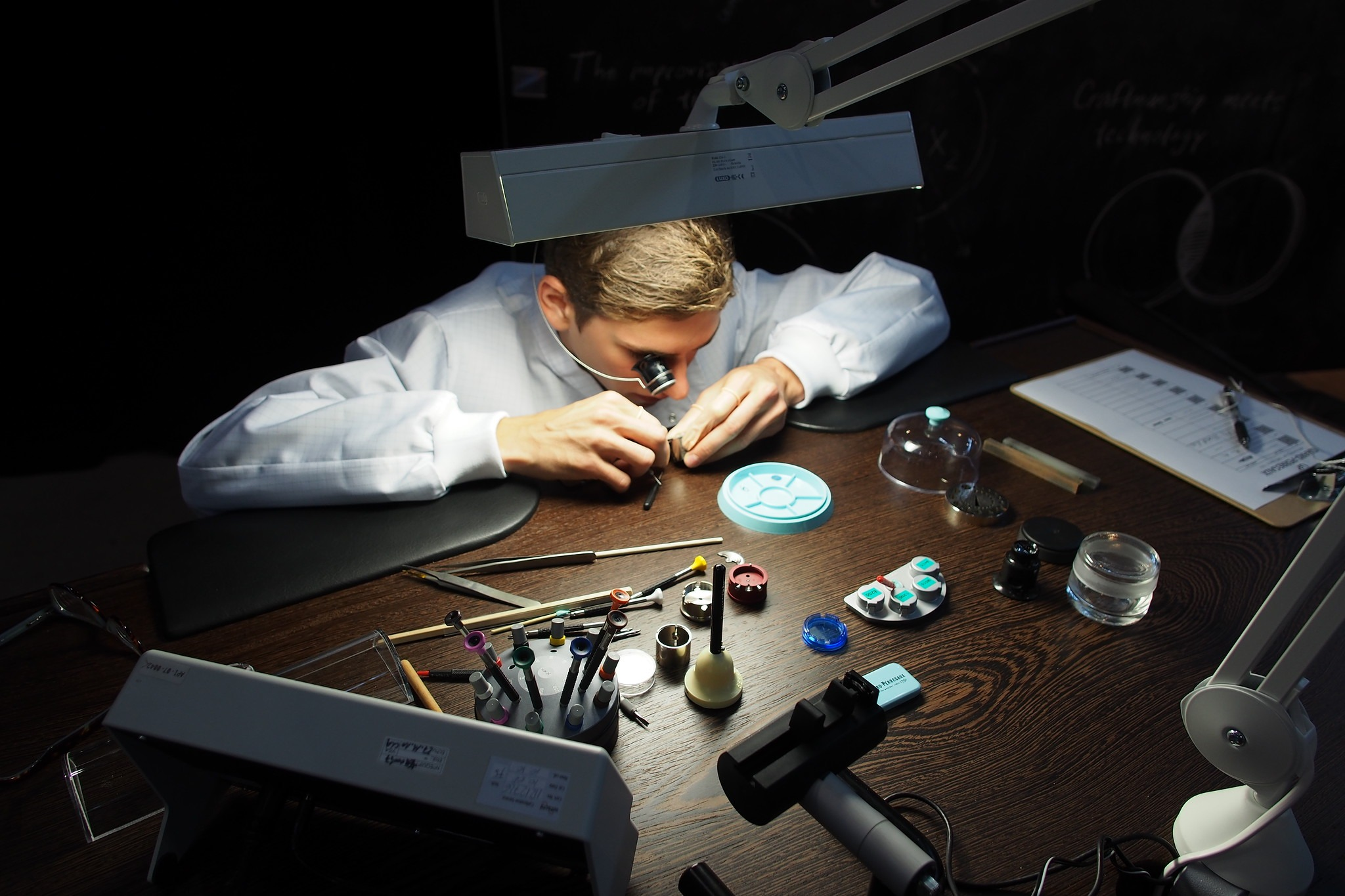 watchmaker assembling a watch