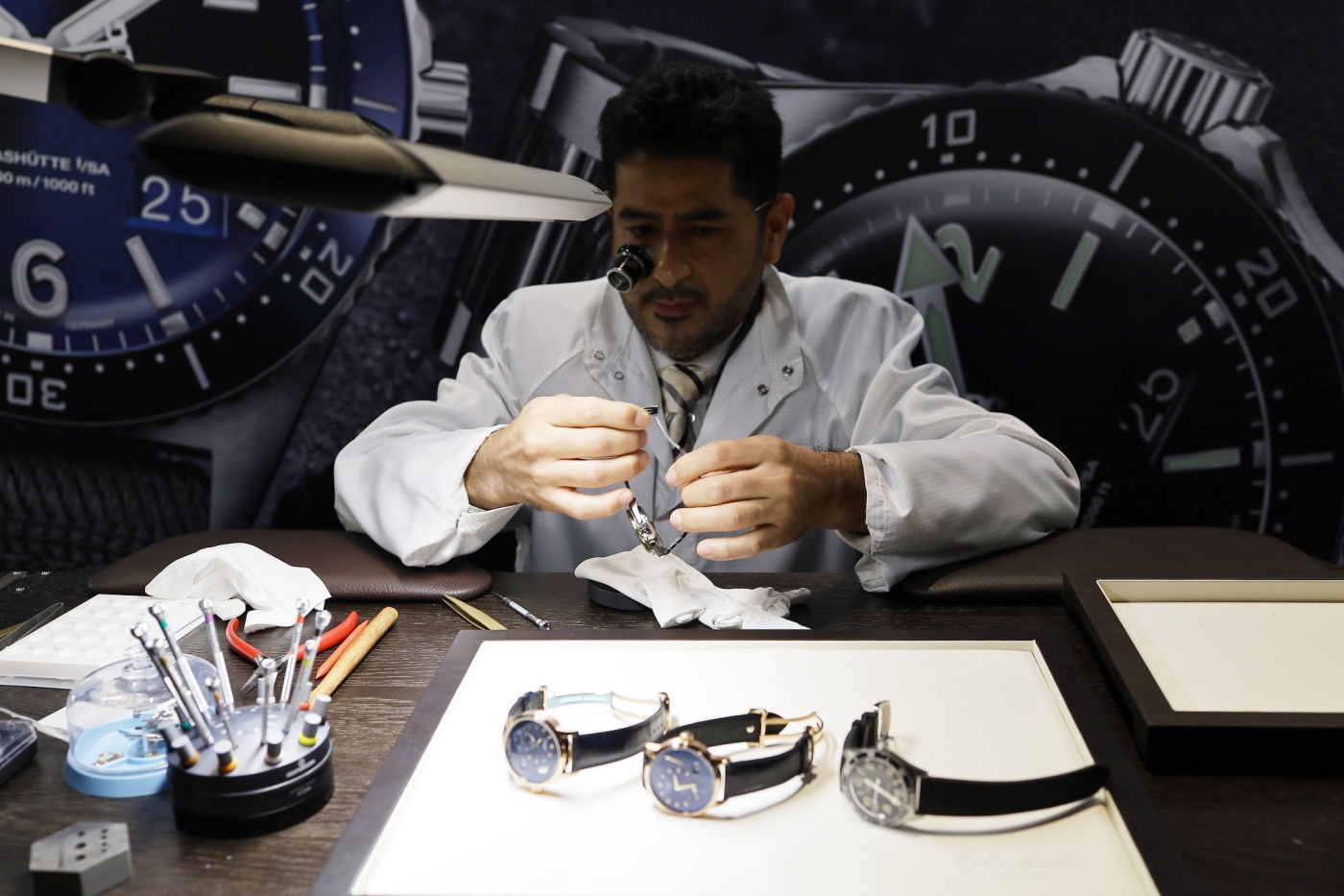 Glashutte Original watchmaker making adjustments at WatchTime