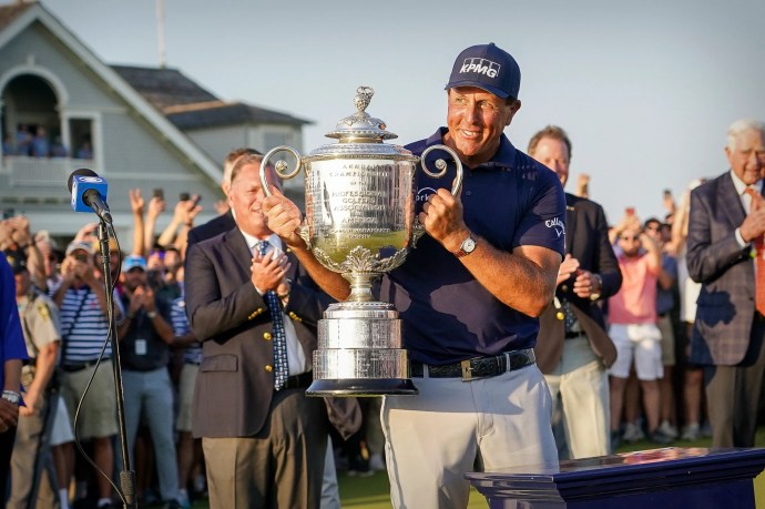 USA Today Phil Mickelson hoisting 2021 PGA trophy with Rolex Cellini on his wrist