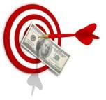 Une cible avec une flèche qui pique un billet de 100 dollars