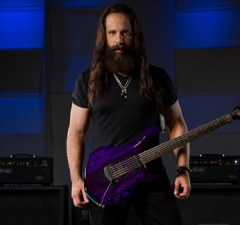 "JOHN PETRUCCI Started Playing Guitar Because He Wanted to ""Stay Up Late"""