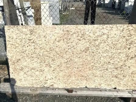 Warm beige and peach granite remnant