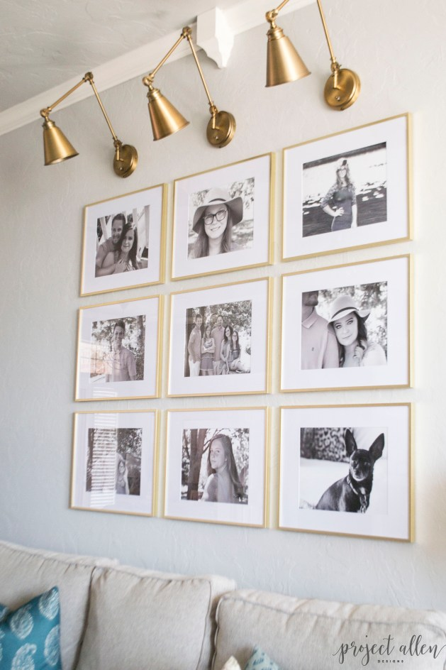 Creating a Grid Style Gallery Wall with these easy tips and tricks. Brass matted picture frames, brass swing arm sconces turned into a gallery wall creates the perfect backdrop for our sofa.