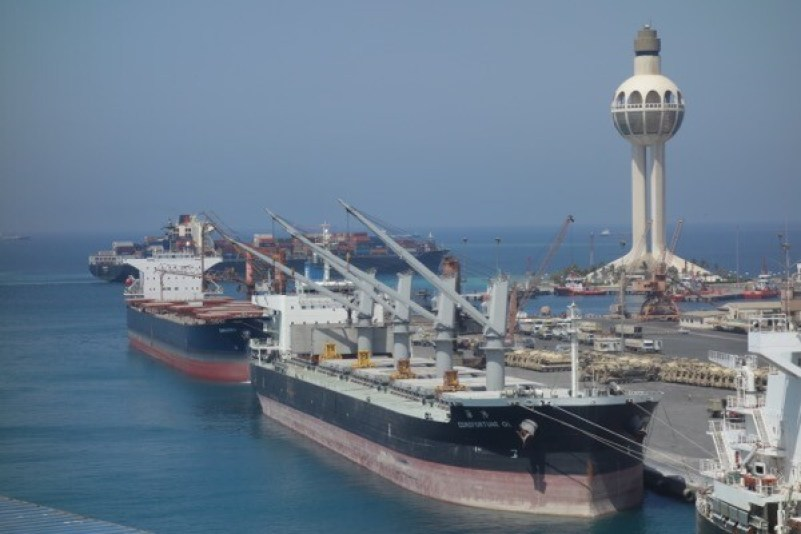 Busy day in Jeddah, Saudi Arabia with 2 bulkers alongside, tanks ready on the pier for transport or inland movement and a container ship just leaving. As usual, the temperature was over 40° centigrade.
