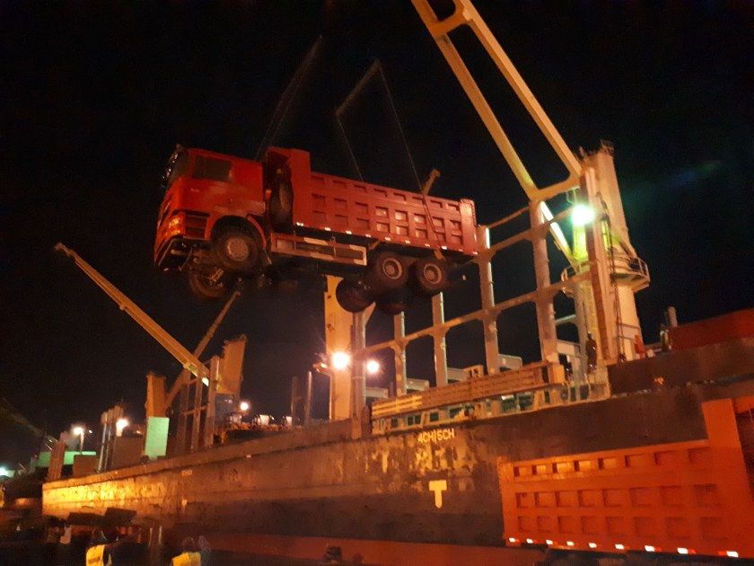 loading a big truck onto a vessel