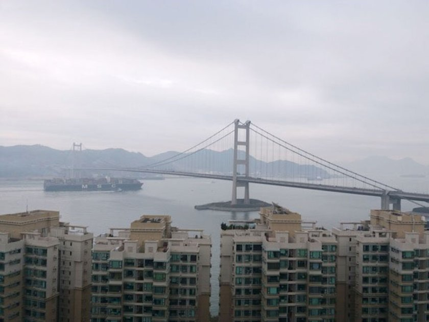 The view from Project Cargo Weekly's 32nd floor Hong Kong office on Park Island. A shipping view indeed, looking at a 13,000 TEU MSC vessel passing under the Tsing Ma Bridge.