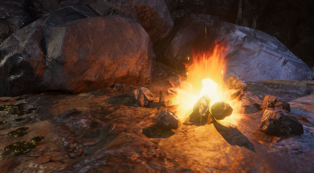 Screenshot from Unity showing a campfire in a dark cave room