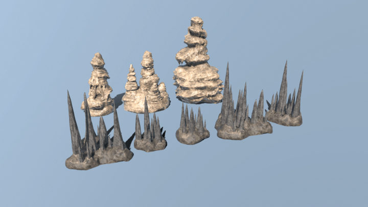 2 rows of flowstone and stalagmite set pieces lined up