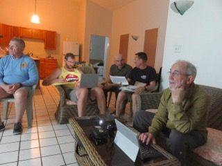 bentprop crew analying sonar image for possible aircraft in palau