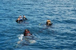 divers make their first open water dive with new full face masks in palau with bentprop