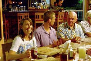 smiling at dinner in palau after finding a lost wwii aircraft