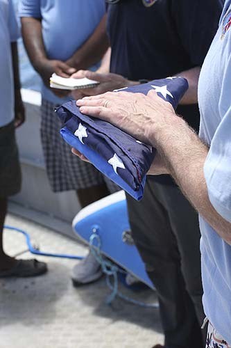 Both flags in the flag bearer's hands.