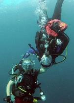 divers taking a safety stop while diving in palau with bentprop.org