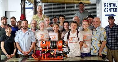 team bentprop stands with ROV built by stockbridge students
