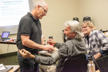 Wilderness First Responder Course learning to apply large bandage