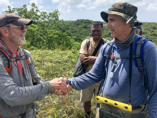 Glenn Frano receives his BentProp Coin on his first mission in the jungles of Palau by Team Leader Pat Scannon during Palau WWII POW search