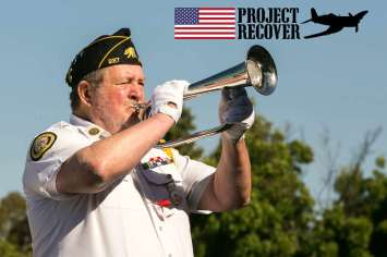 Bugler playing Taps at Memorial Day Service For Lt. Thomas Kelly. Photo by Harry Parker PHotography