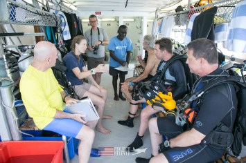 Pre dive checklist aboard the Taka Live a Board scuba diving ship - Scuba diving MIA crash sites - Project Recover and BentProp Project are committed to bringing the MIA home. Photos by Harry Parker Photography.com