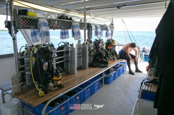 Taking a rest aboard the TAKA scuba diving ship after a deep dive documenting a B24 WWII aircraft wreck during Solomons MIA Search - Project Recover and BentProp Project are committed to bringing the MIA home. Photos by Harry Parker Photography.com