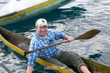 Derek Abbey trying out a hand made dug out canoe during Solomons MIA Search - Project Recover and BentProp Project are committed to bringing the MIA home. Photos by Harry Parker Photography.com