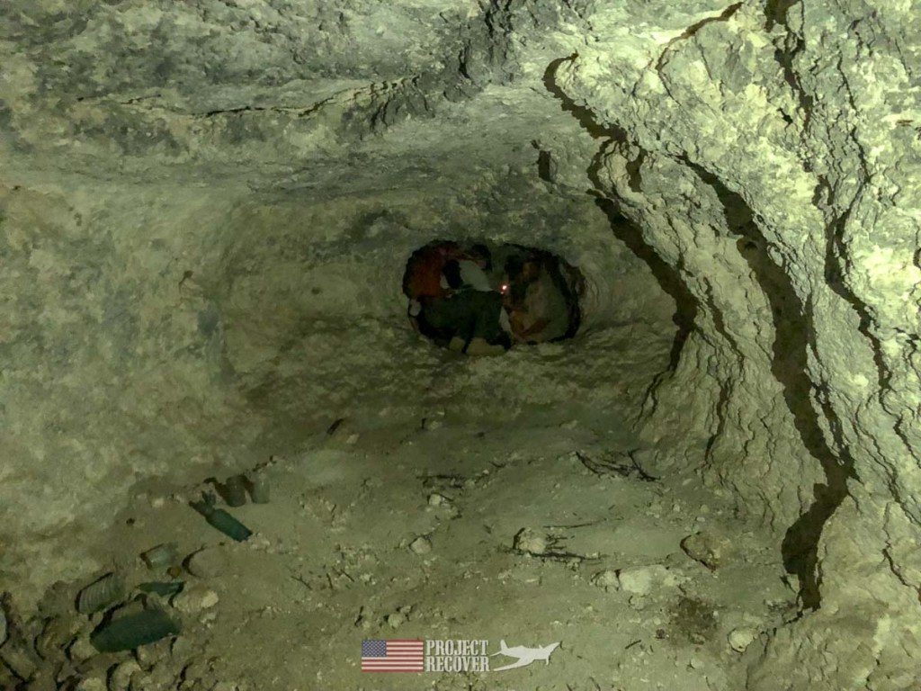 Project Recover and Cleared Ground Demining team members inside WWII Japanese cave on Peleliu.