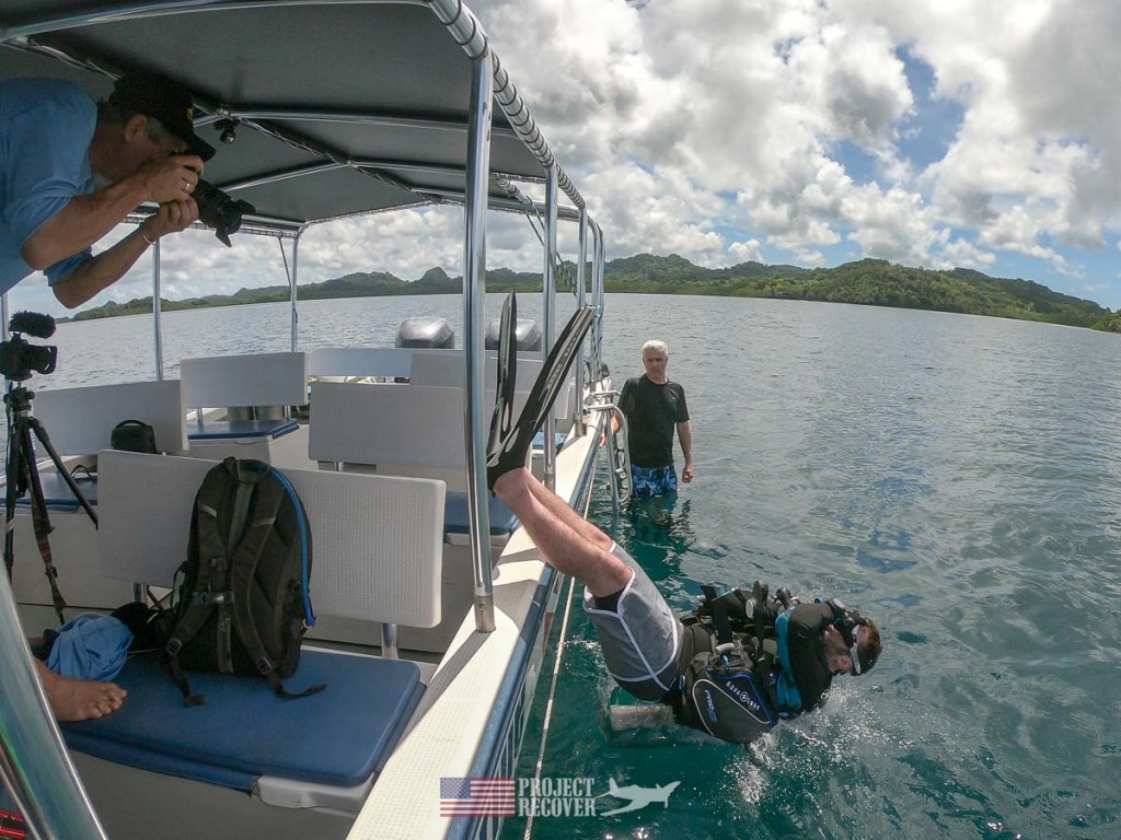 Adam (MIA Family) enters water for dive to his uncle's WWII plane wreck. Photo by Dan O'Brien
