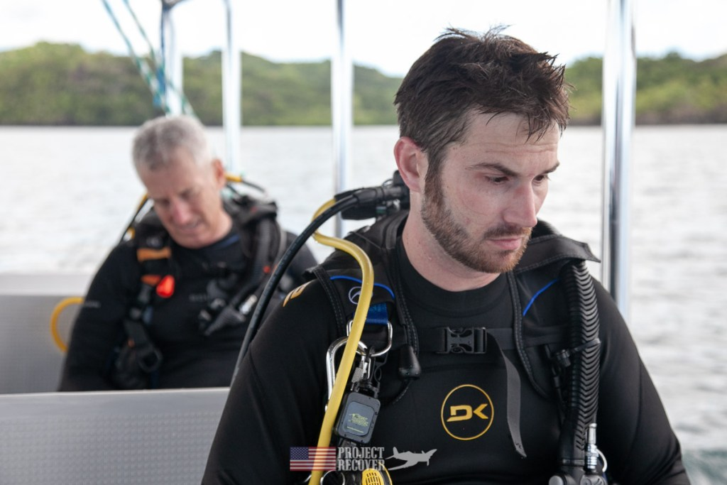 Adam Gray (MIA Family) contemplates dive to uncle's wreck in Palau. Photo by Harry Parker Photography.
