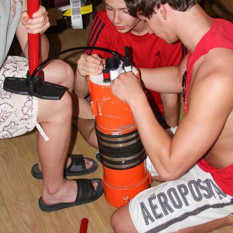 students working on an underwater robot