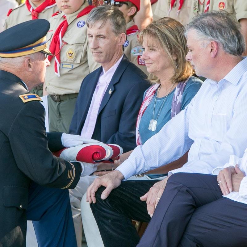 Diane Christie receives a ceremonial flag