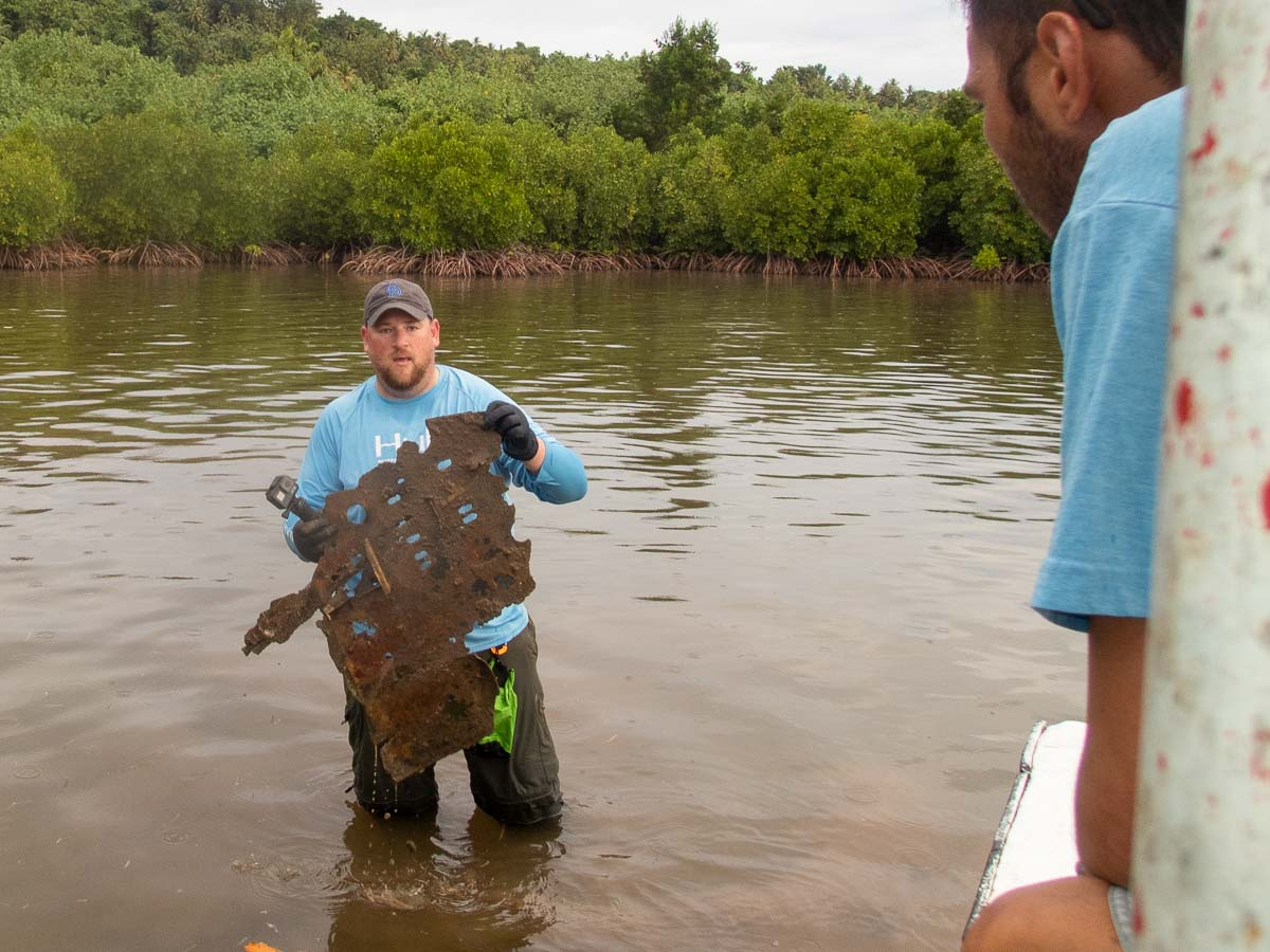 Dr. Colin Colbourn holding Aircraft Wreckage
