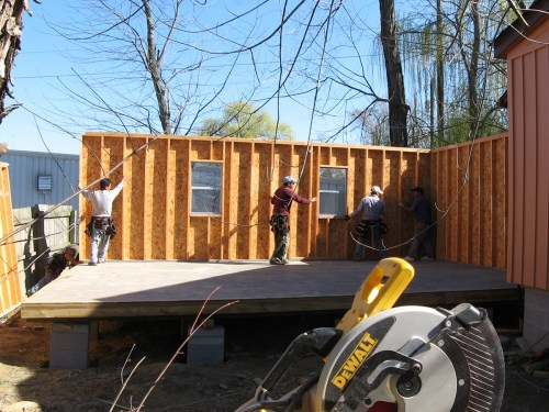 Sliding the wall into place - Our Classic Manor New Day Cabin - Project Small House