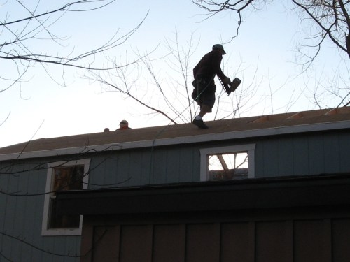 Nailing the roof beams into place - Our Classic Manor New Day Cabin - Project Small House