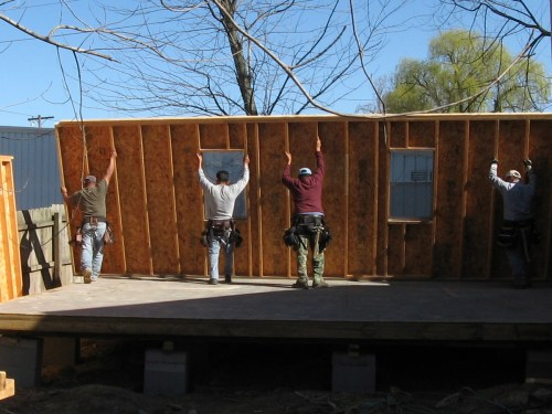 Putting up the first wall - Our Classic Manor New Day Cabin - Project Small House