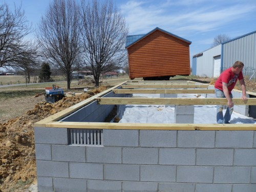 Amish Made Cabin being installed on a block foundation - Project Small House