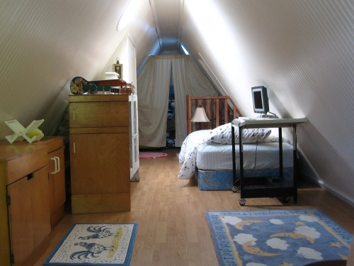 Project: Turning the Attic into a Playroom - Play room in the attic with beadboard walls, click-lock floor.