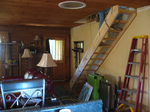 Project: Turning the Attic into a Playroom - Carpenter installing the stairs to the attic playroom