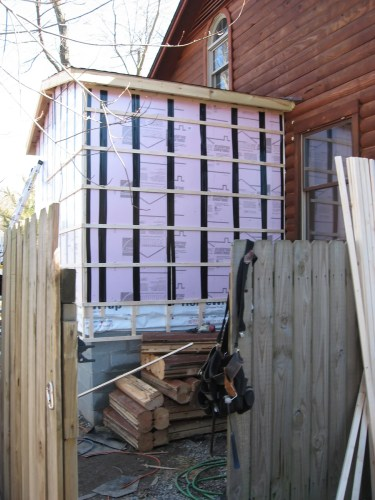 Project: Adding Closets to the log cabin - Those are the logs we cut out to make the doors.